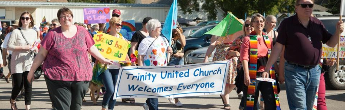 trinity banner and group including beth julie don pam diana